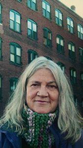 photo of Elizabeth McKim in front of a brick building