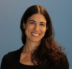 Julie Danho's head and shoulders against a blue background